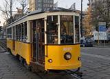 Italy Creative - yellow tram in Milan